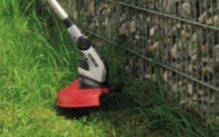 PRÄZISE BIS AN DEN RAND  Dank Pflanzenschutzbügel und Laufrad können Sie auch unter Büschen oder an Wänden und Mauern ganz exakt und beruhigt trimmen ohne Schäden anzurichten.
